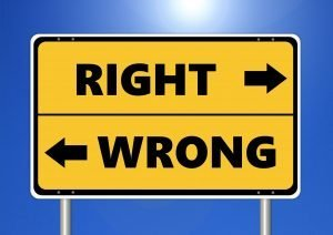 Yellow And Blue Sign Saying Right And Wrong To Show Ethical Integrity
