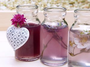 colored water in three jars