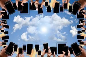 circle of smartphones with clouds above