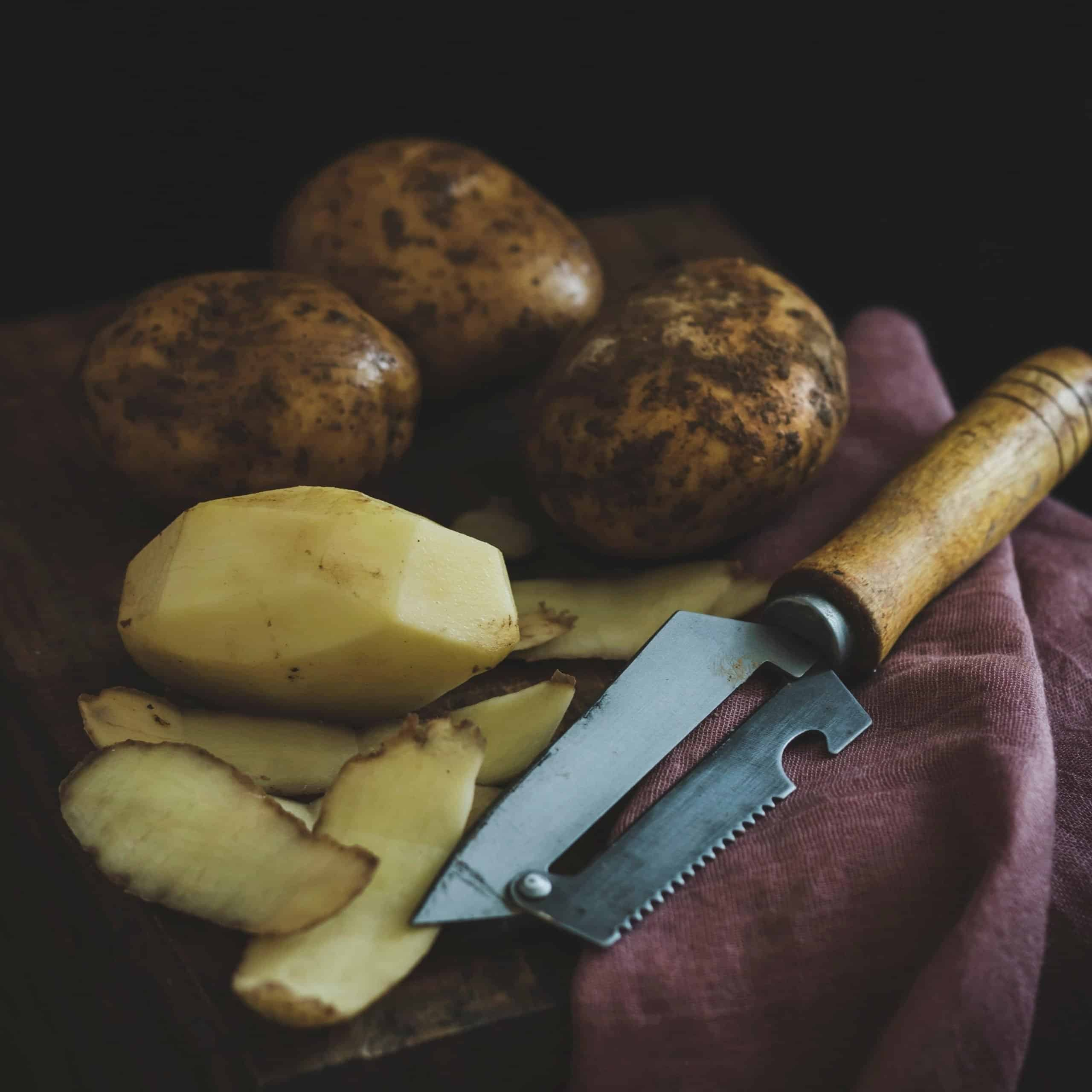 potatoes and knife representing starchy carbohydrate