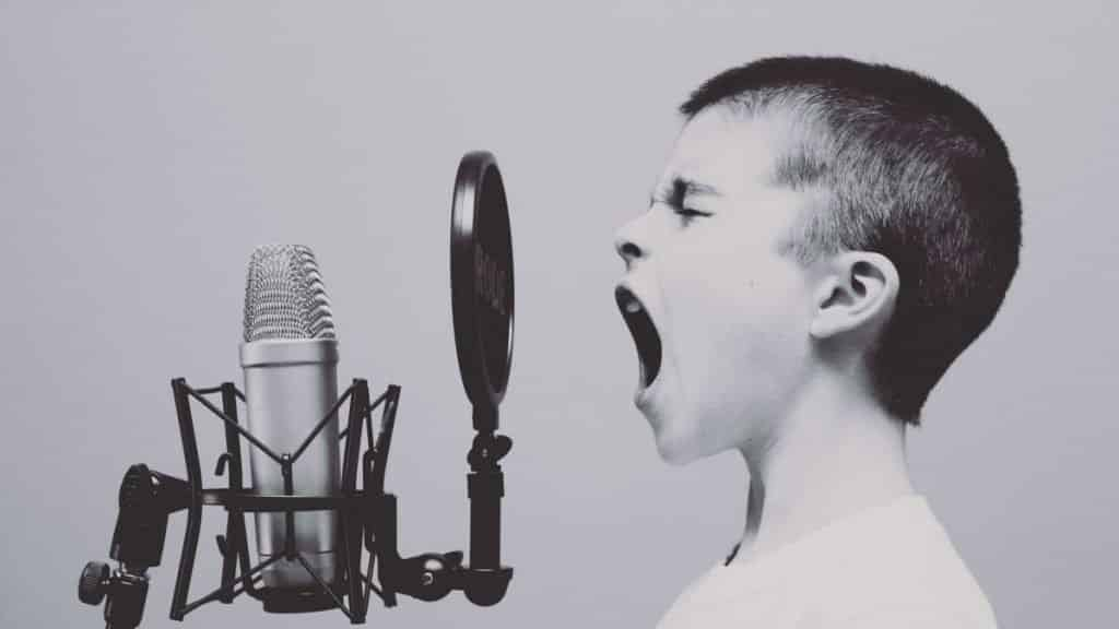 sustainable living boy shouting into microphone