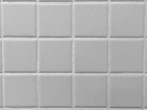 unsealed white grout against grey tile