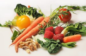 Various Vegetables Representing The 6 Essential Vitamins And Minerals
