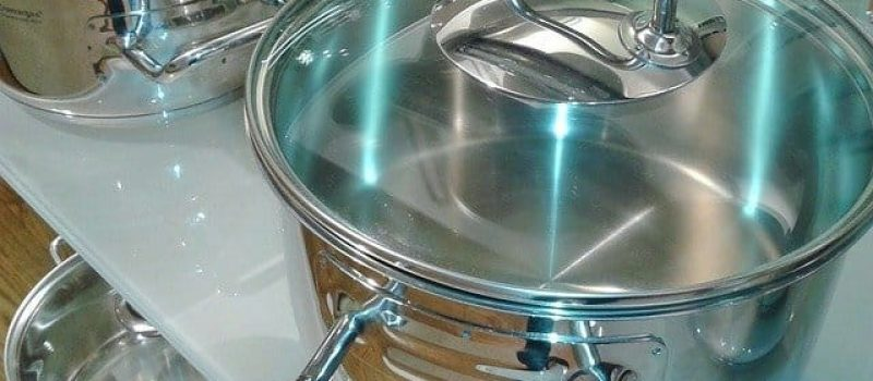 stainless steel cooking in eco-friendly kitchen